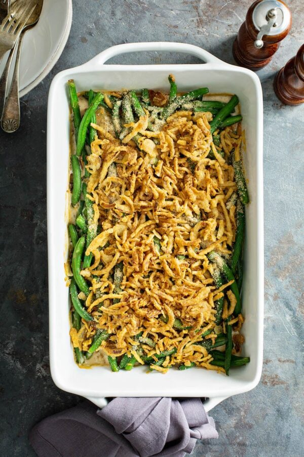 Green bean casserole recipe made from scratch in a white 9x13 casserole dish.