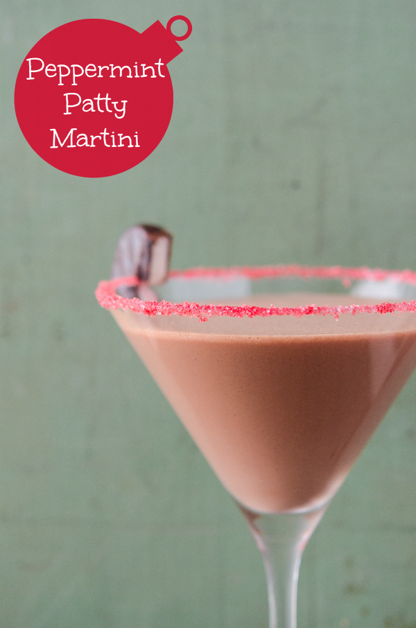 A martini glass with a red sugar rim is filled with a peppermint chocolate cocktail