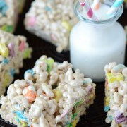 A Platter of Lucky Charm Marshmallow Treats Beside a Glass of Milk with Three Straws