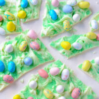 Nine Pieces of Easter Egg Bark Candy on a White Surface