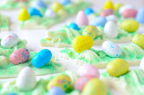 Pieces of White Chocolate Bark for Easter on a White Countertop