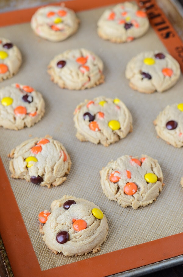 A baking sheet with rows of Reese's Pieces Peanut Butter Cookies