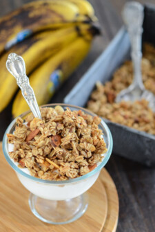 Banana Nut Granola served over yogurt in a glass dish with a spoon