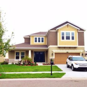 Exterior photo of new home with a white Ford Expedition in the driveway
