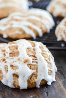 Iced Apple Pie Cookies on a dark surface