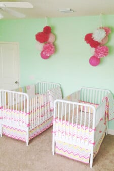 Twin girl's nursery with cribs (green, pink, white, and yellow)