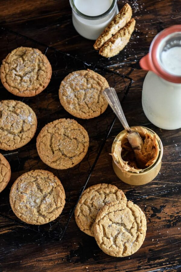 Peanut Butter Cookies on a cooling rack with milk.