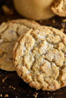 Close up of two Peanut Butter Cookies with soft centers and surrounded by crumbs