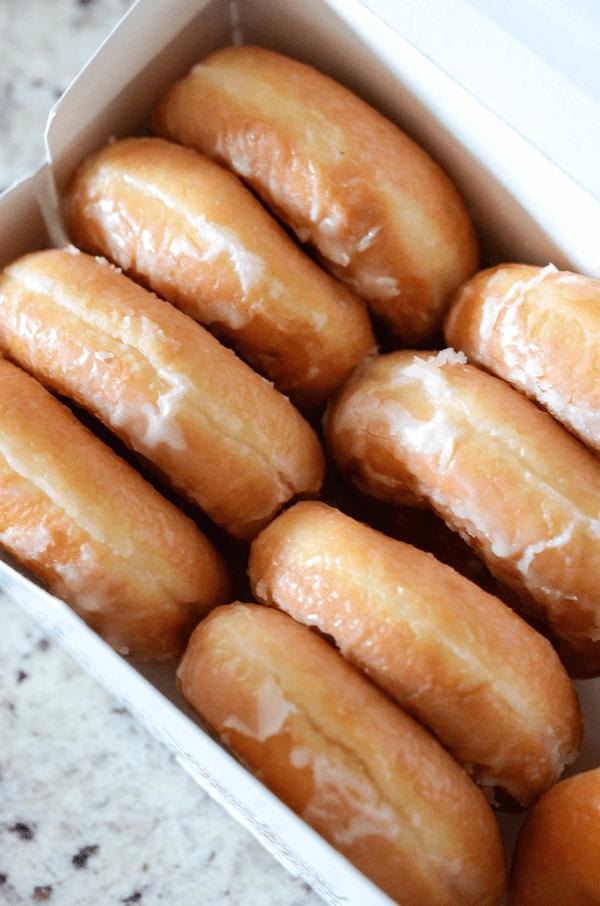 Leftover krispy kreme donuts in a box.