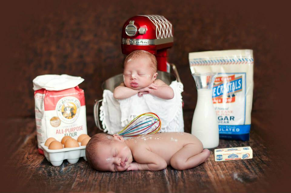 Two Newborn Babies Posed with Eggs, Milk, a Mixer and Other Kitchen Items