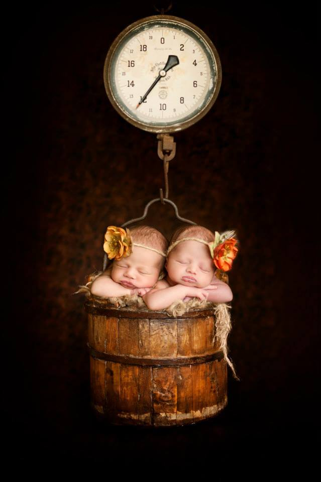 Two Newborns Sleeping in the Barrel of an Old Wooden Time Scale