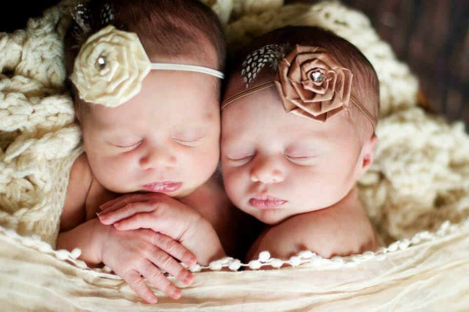 A Close-Up Shot of the Faces of the Twins While They Sleep in a Rocker with Blankets