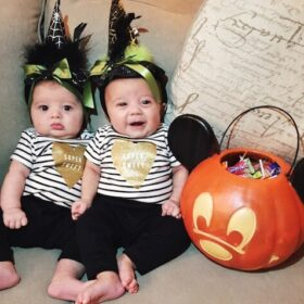 Twin girls first halloween in black and white outfits