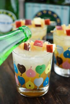 Ginger Bourbon Apple Cider being poured into short glasses