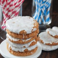 Stack of Old Fashioned Iced Oatmeal Cookies on a white stand