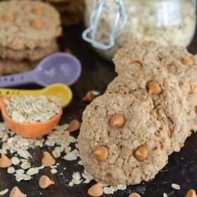 Oatmeal Scotchies with butterscotch chips and measuring spoons with oats