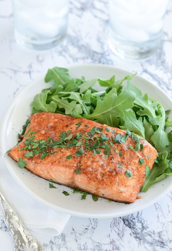 Balsamic Roasted Salmon on a white plate with a fork
