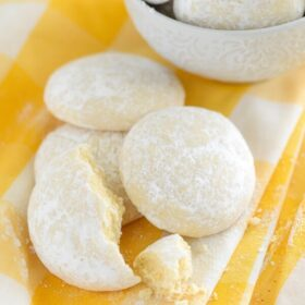 Lemon Cooler Cookies on a yellow and white cloth and in a white bowl