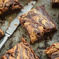 Banana Brownies with a Peanut Butter Swirl on a Metal Baking Sheet
