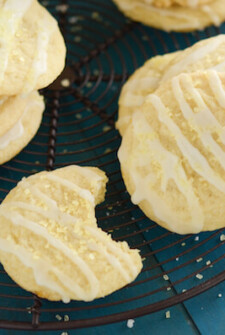 Lemon Chiffon Cookies on a black rack and teal background
