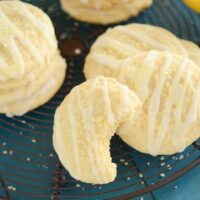 Lemon Cookies with Lemon Drizzle Icing on Top of a Wire Rack on a Table