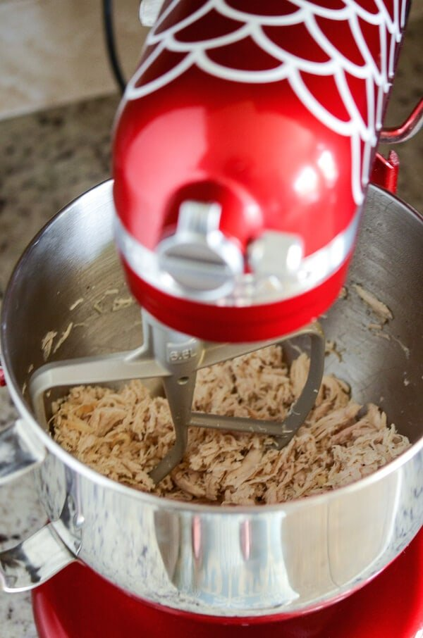 Best Shredded Chicken Recipe: This method is the easiest and most flavorful way to make shredded chicken to use in other recipes! Plus, it only takes 20 minutes and you can make enough to freeze!