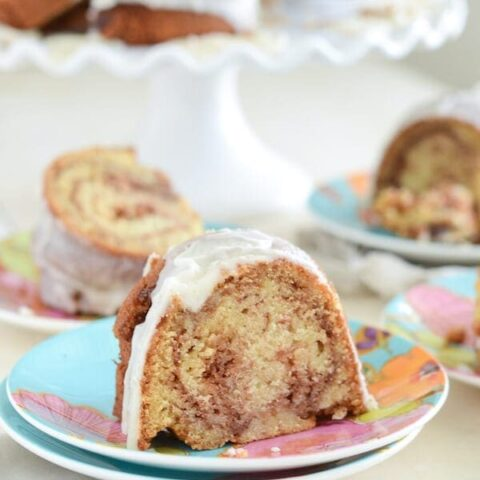Slices Honey Bun Cake on colorful plates with forks