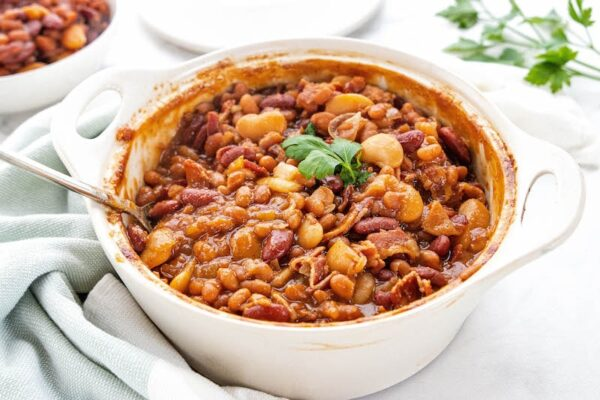 Baked beans in white cast iron pot.