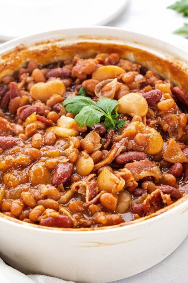 Large white bowl of baked beans.