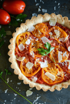 Heriloom Tomato Tart topped with shaved parmesan