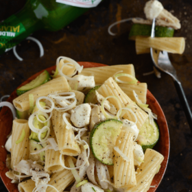 Chicken, Fennel & Zucchini Pasta Salad in a wooden bowl with a sprinkle of pepper