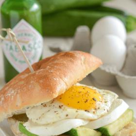 Zucchini, Mozzarella & Fried Egg Spicy Breakfast Sandwich on a white plate