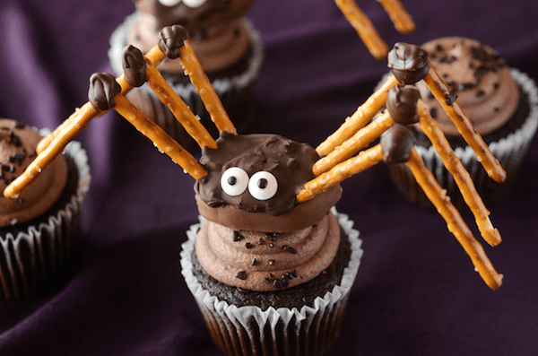A Homemade Halloween Pretzel Spider Sitting on Top of a Cupcake