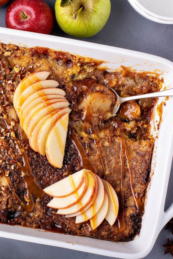 Caramel Apple Dump Cake in a white casserole dish.