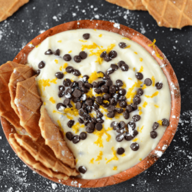 Chocolate Orange Cannoli Dip with waffle cone chips topped with orange zest and chocolate chips