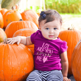 Little girl in a pumpkin patch