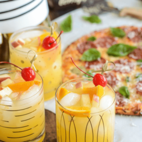 Sparkling Autumn Spiced Sangria topped with a cherry and orange skewer