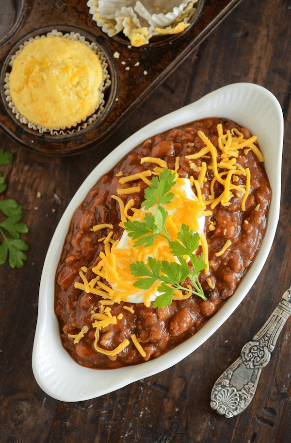 A Casserole Dish of Slow Cooker Bean Chili Topped with Shredded Cheese