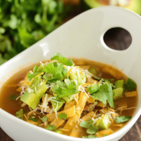 Slow Cooker Chicken Tortilla Soup in a white bowl