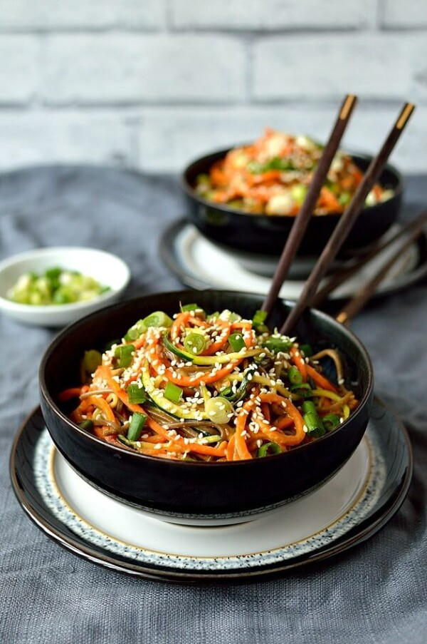Two Vegetable Noodle Bowls With Peanut Sauce and Two Pairs of Chopsticks