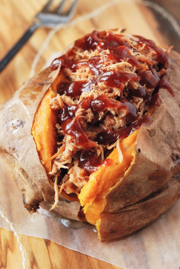 Baked sweet potato stuffed with pulled pork and drizzled with bbq sauce.