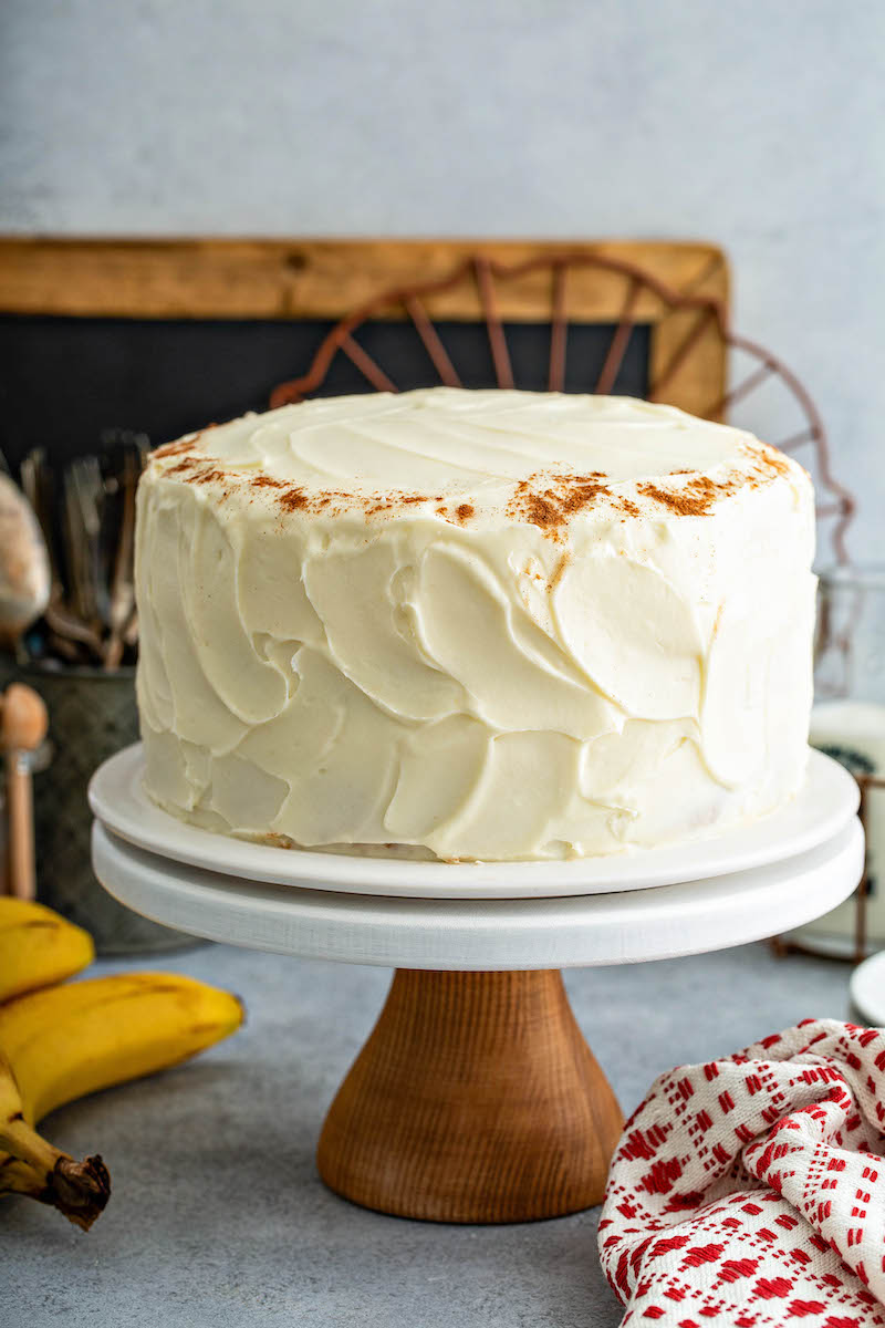 Frosted banana cake on a table.