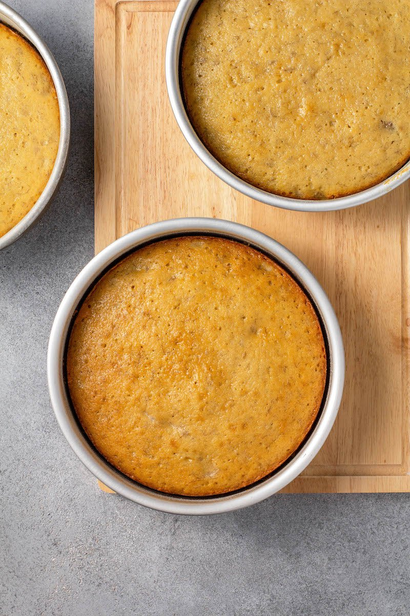 Banana cake layers in pans.