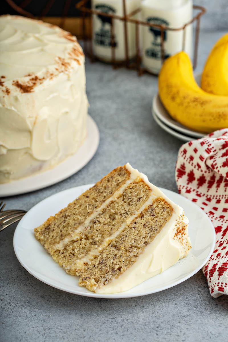 Slice of banana cake on a plate.