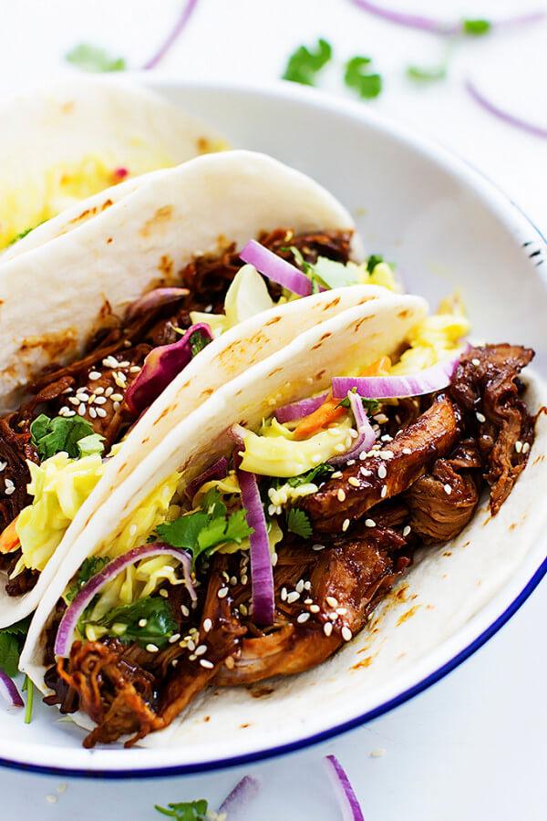 Korean BBQ Pork Tacos on a White Plate