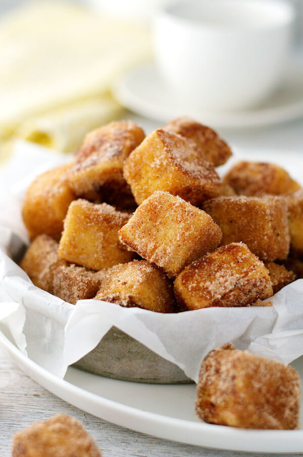 Cinnamon Sugar French Toast Bites Piled in a Serving Dish