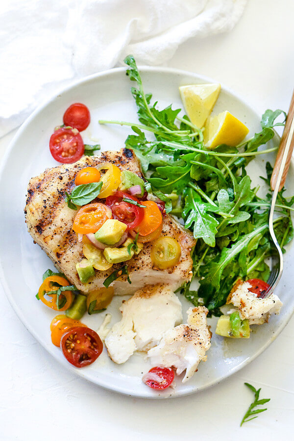 A Plate of Grilled Halibut with Tomato Avocado Salsa