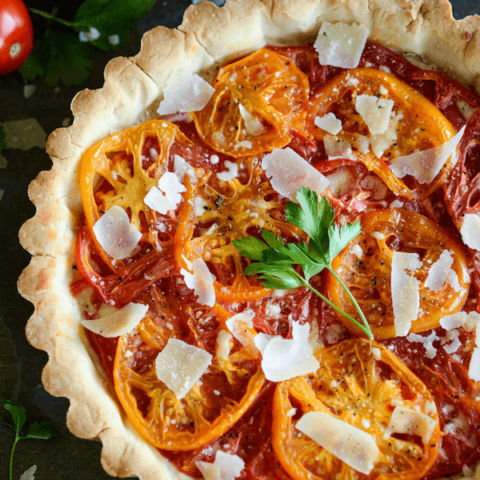 An Heirloom Tomato Tart Topped with Shaved Parmesan