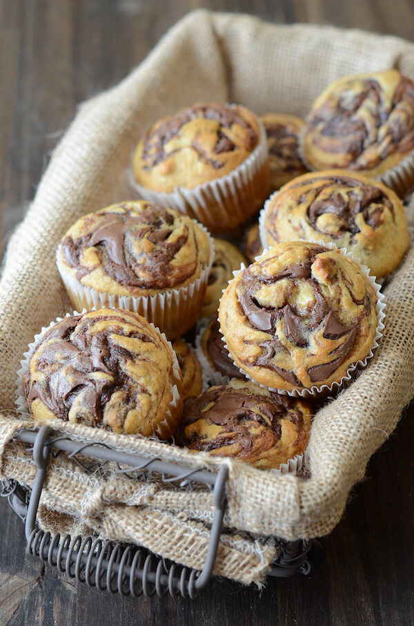 Nutella Banana Swirl Muffins in a basket with a burlap insert