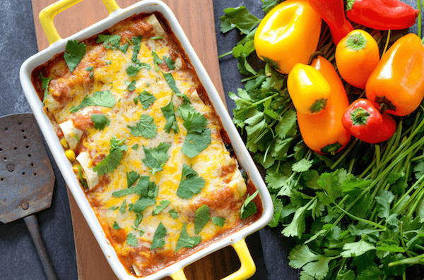 Healthy Vegetable Enchiladas are stuffed with tons of vegetables and gooey cheese!